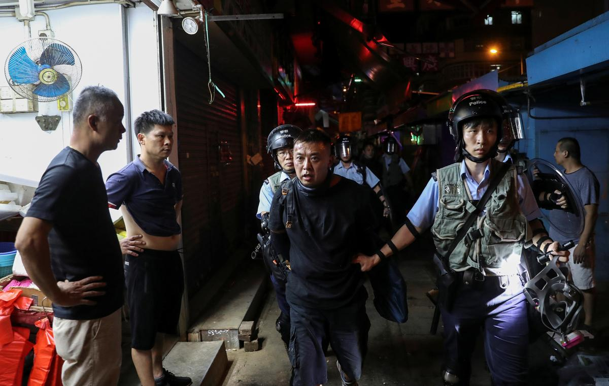 China sê troepe sal die welvaart van Hong Kong verdedig voor die beplande optog van demokrasie