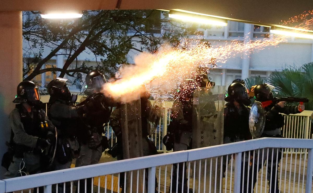 Hong Kong police fire tear gas as protesters hurl petrol bombs