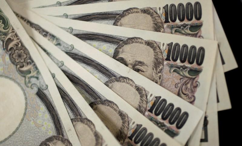A picture illustration shows Japanese 10,000 yen notes featuring a portrait of Yukichi Fukuzawa, the founding father of modern Japan