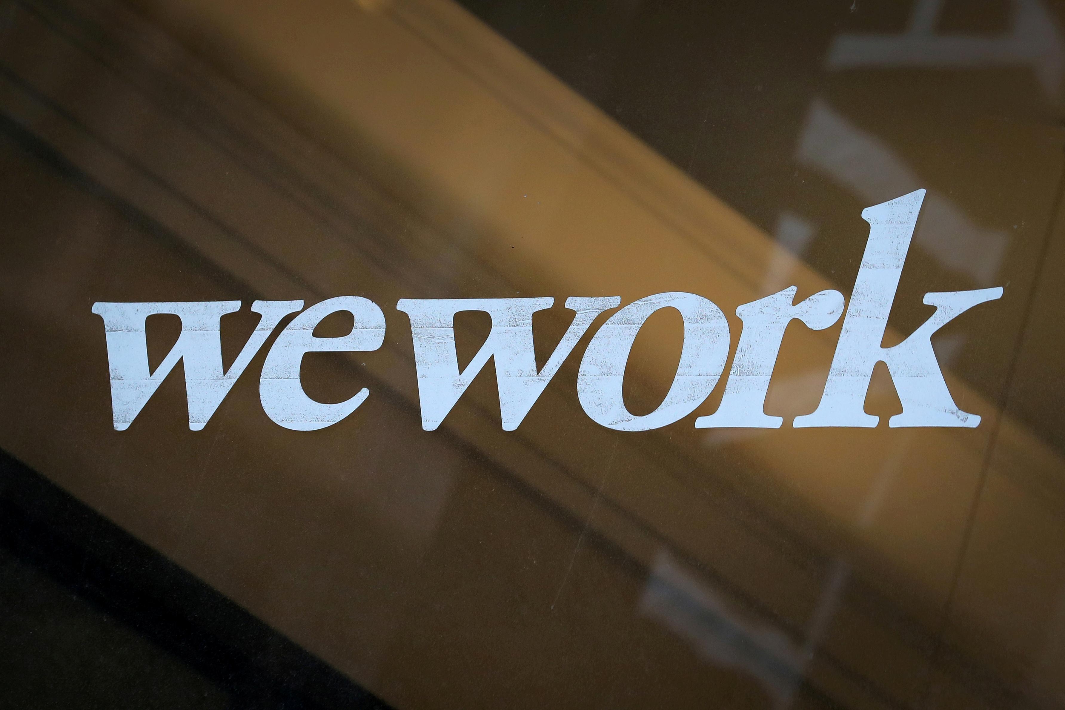 WeWork considers slashing IPO valuation amid pushback: sources