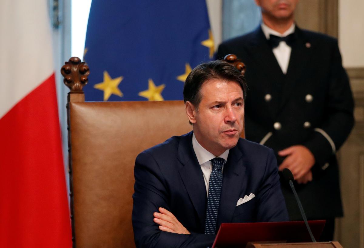 Die eerste minister van Italië sê die nuwe regering sal minder klop