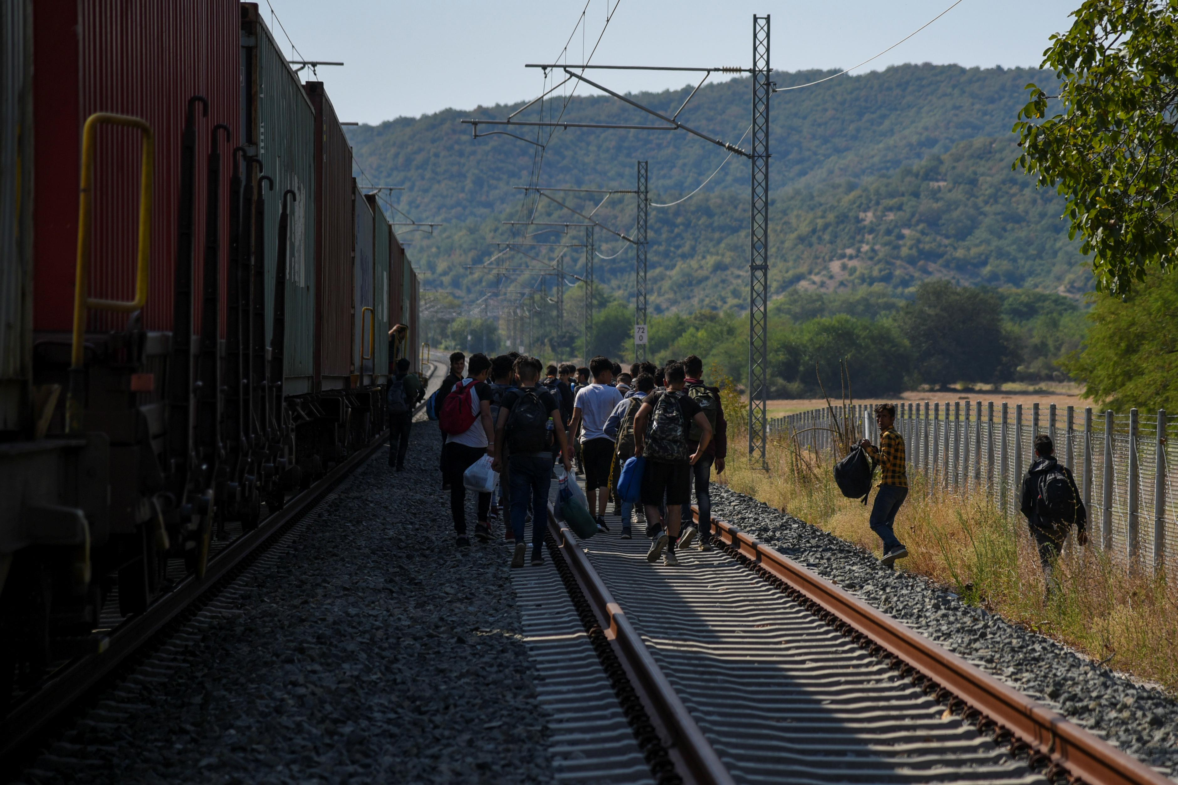 Migrant stowaways ride Greek freight trains seeking escape to north