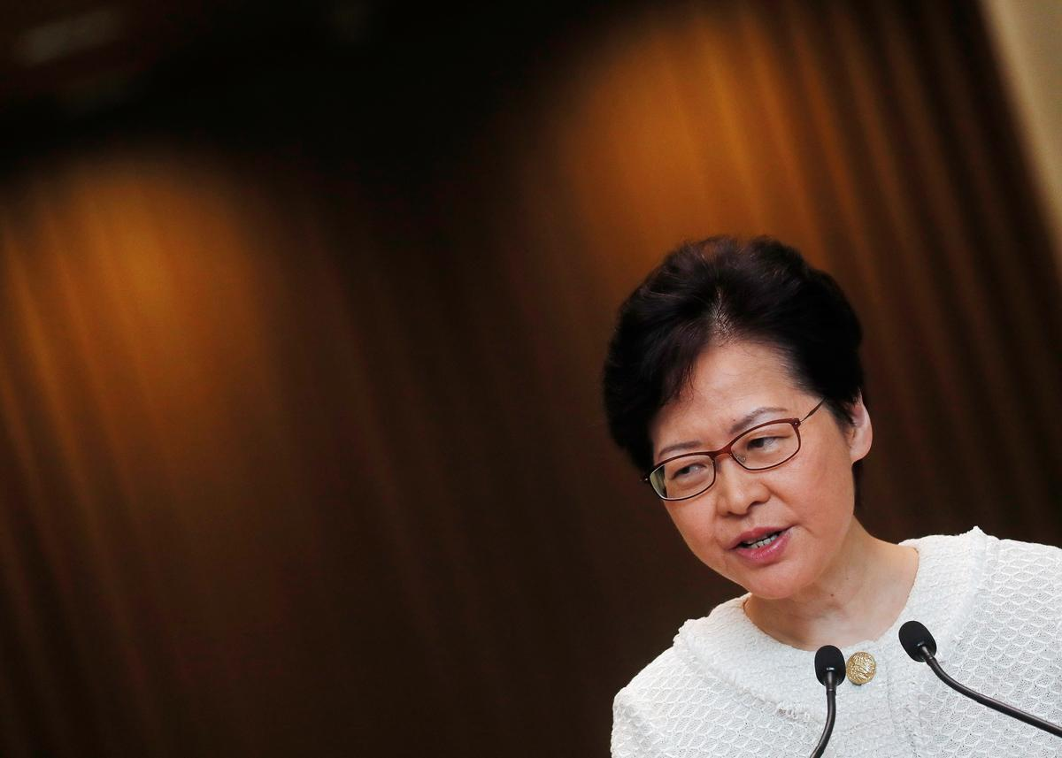 Lantern-waving Hong Kong protesters take to hills, as leader pledges housing reform