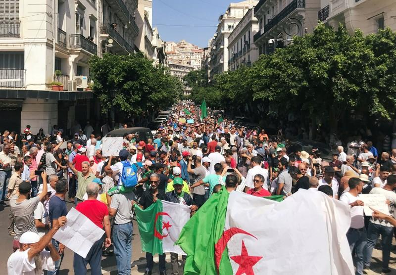 Thousands march in Algeria, say no election before elite quits