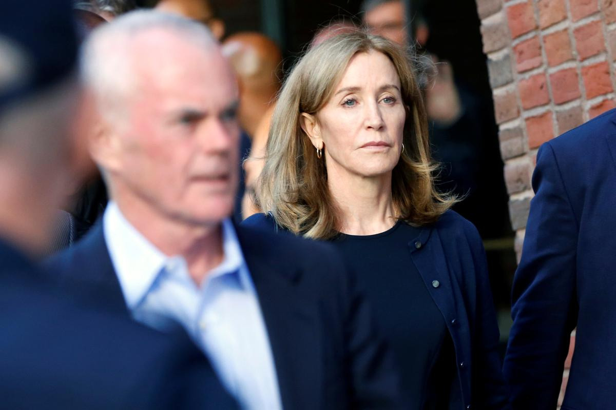 Apologetic actress Felicity Huffman gets 14-day sentence in U.S....