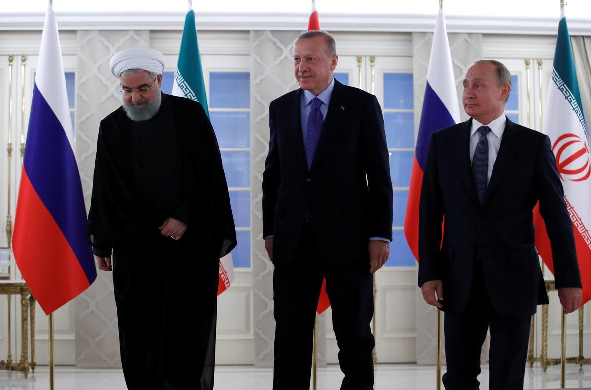 Rusland se Poetin hoop dat samesprekings met Turkye en Iran gronde vir die finale resolusie van Sirië-krisis sal skep