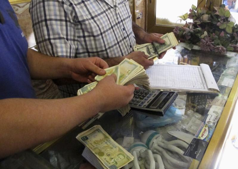 Syria to crack down on profiteers in bid to ease currency crisis