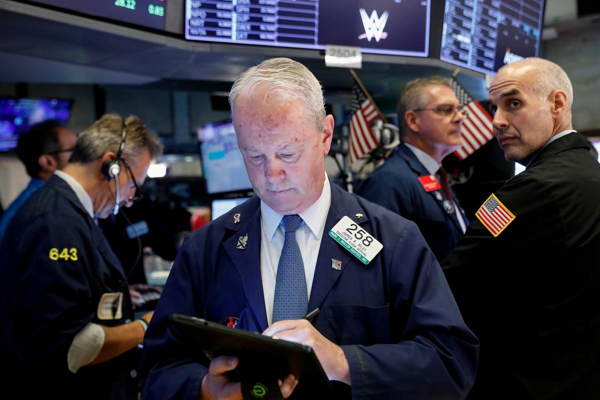 Wall Street sinks after Fed gives mixed signals on next move