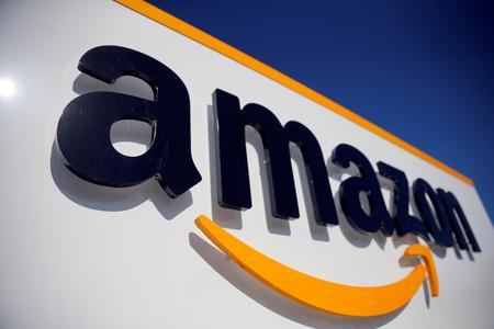 UPDATE 2-Amazon vows to being carbon neutral by 2040; will buy 100,000 EVs