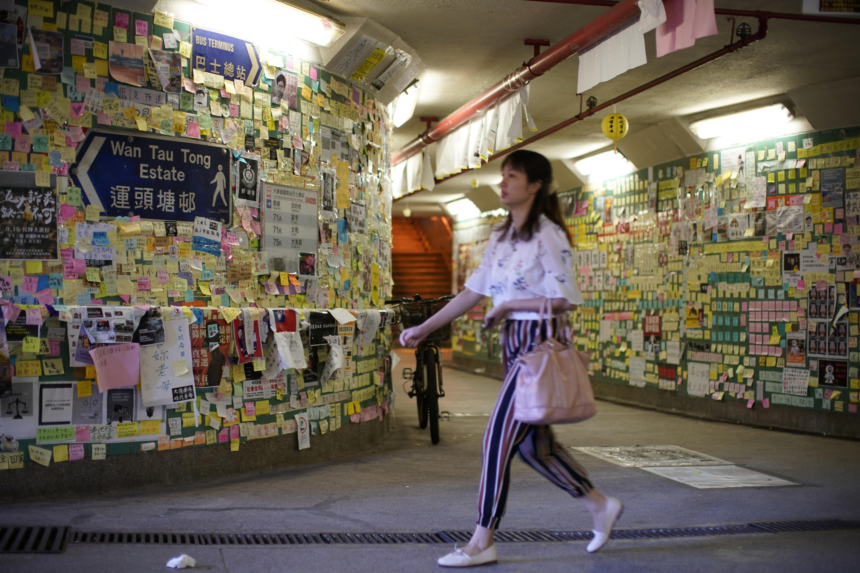 Pro-Beijing groups tear down Hong Kong's protest walls, raising...
