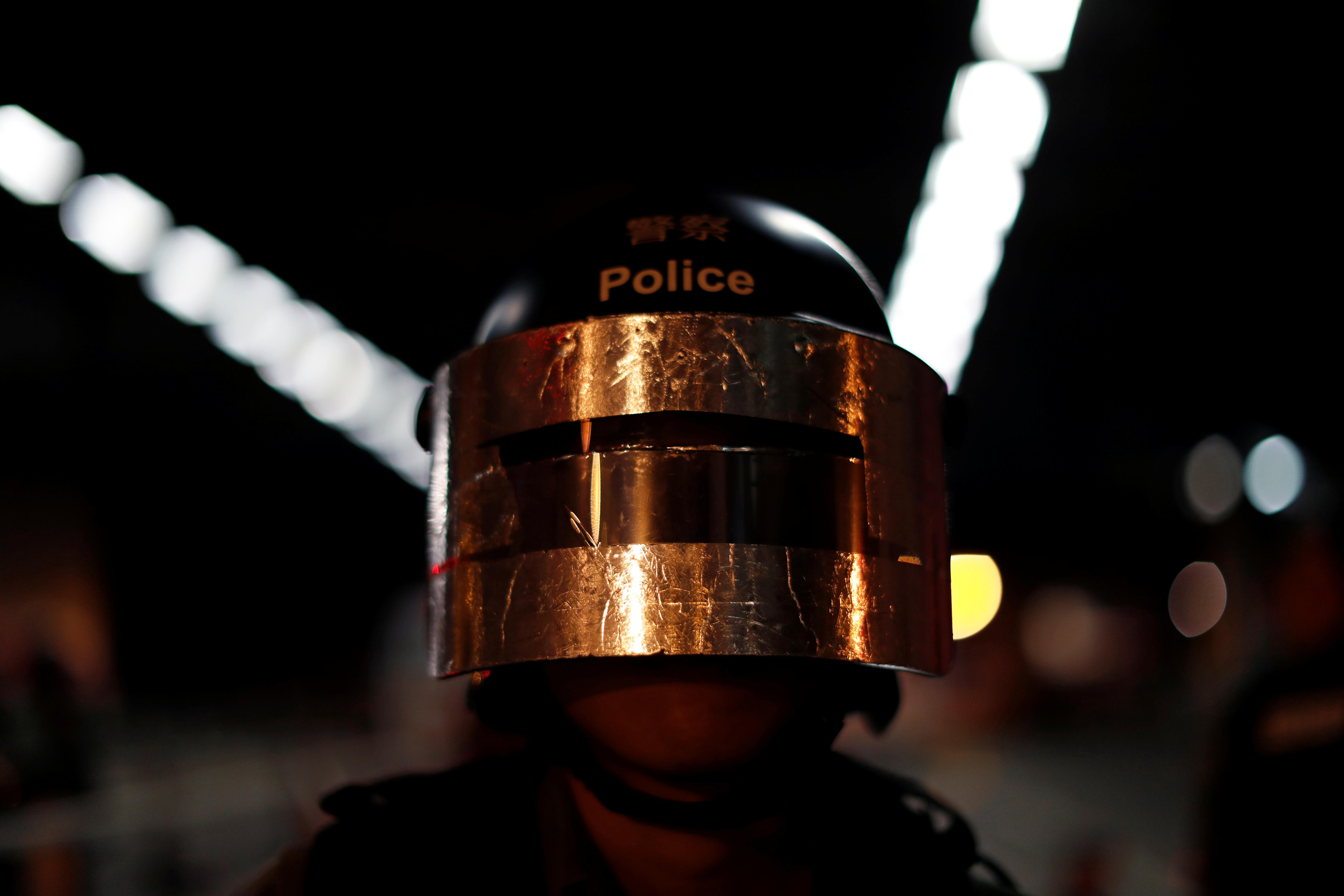 Hong Kong police fire tear gas after protesters throw petrol bombs