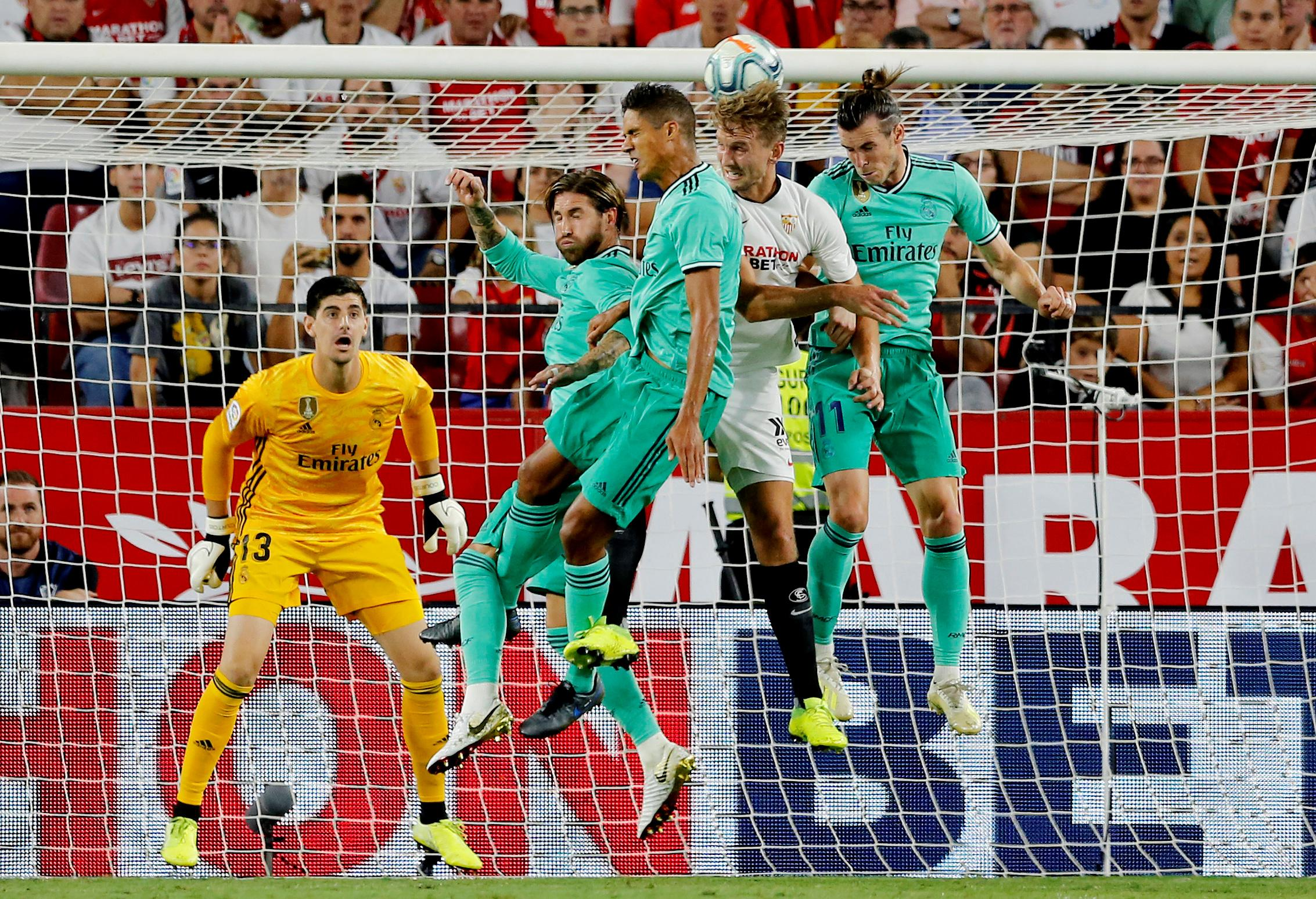 Benzema header beats Sevilla and breathes life back into Real