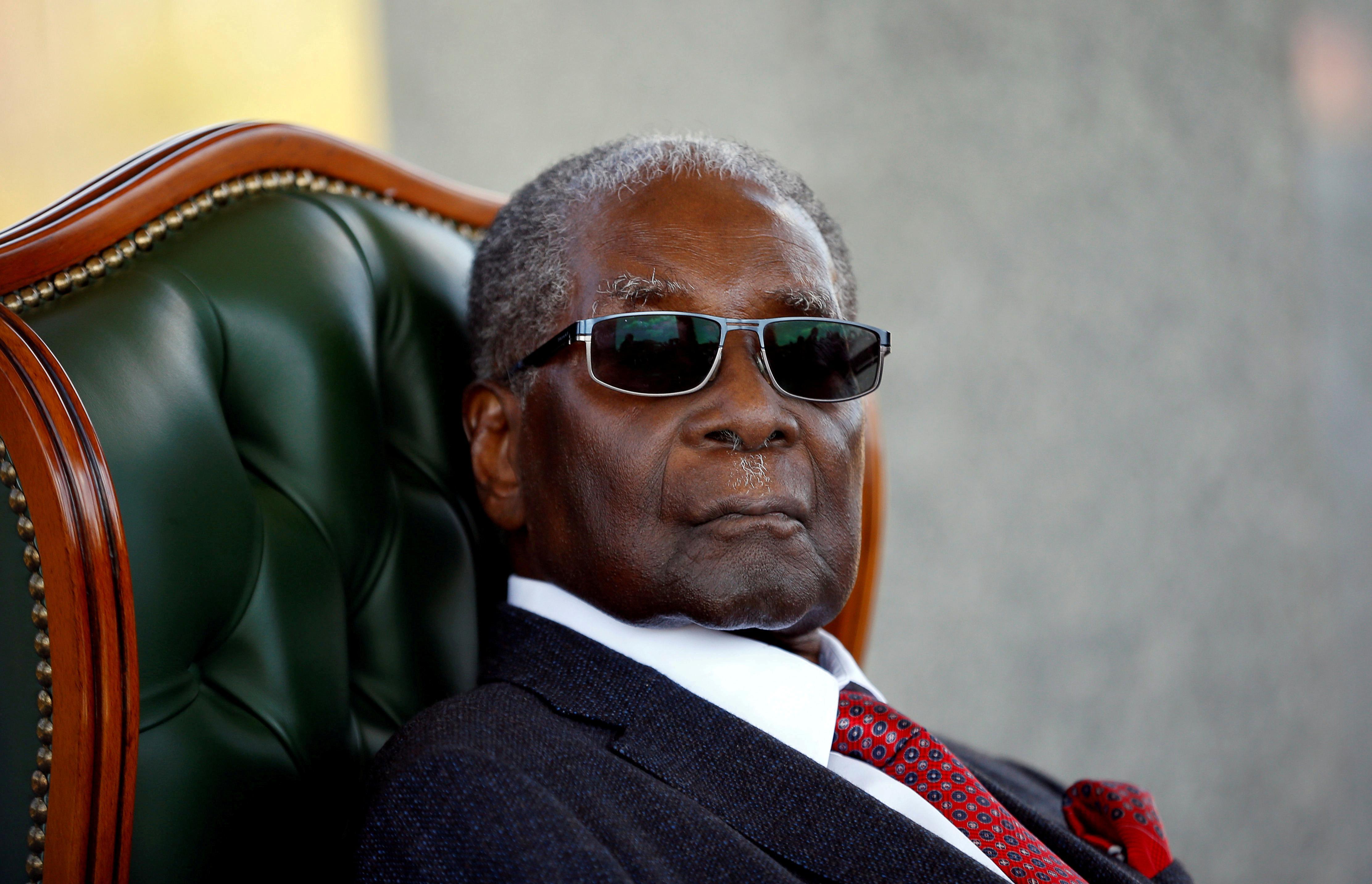 Zimbabwe's Mugabe died from cancer, president says