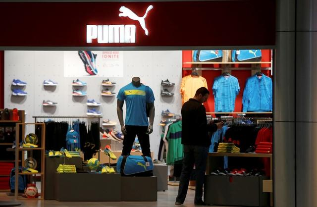 Raza humana crecimiento cartucho  Luxury group Kering trims Puma stake with 500 million euro bond | Reuters