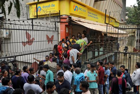 Depositors protest as curbs put on Indian co-operative bank