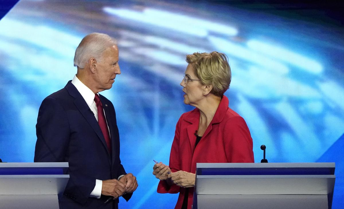 Democratic hopeful Warren catches Biden in national opinion poll