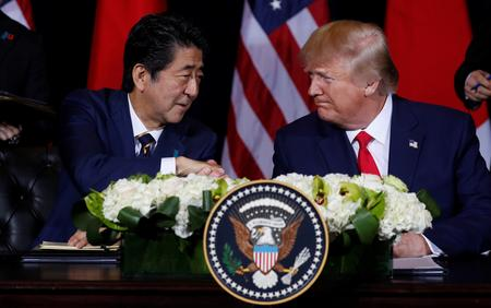U.S., Japan sign limited trade deal, leaving autos for future talks