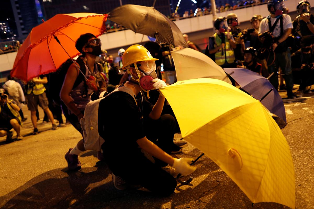 Hong Kong police fire tear gas, water cannon to halt protest as China National Day nears