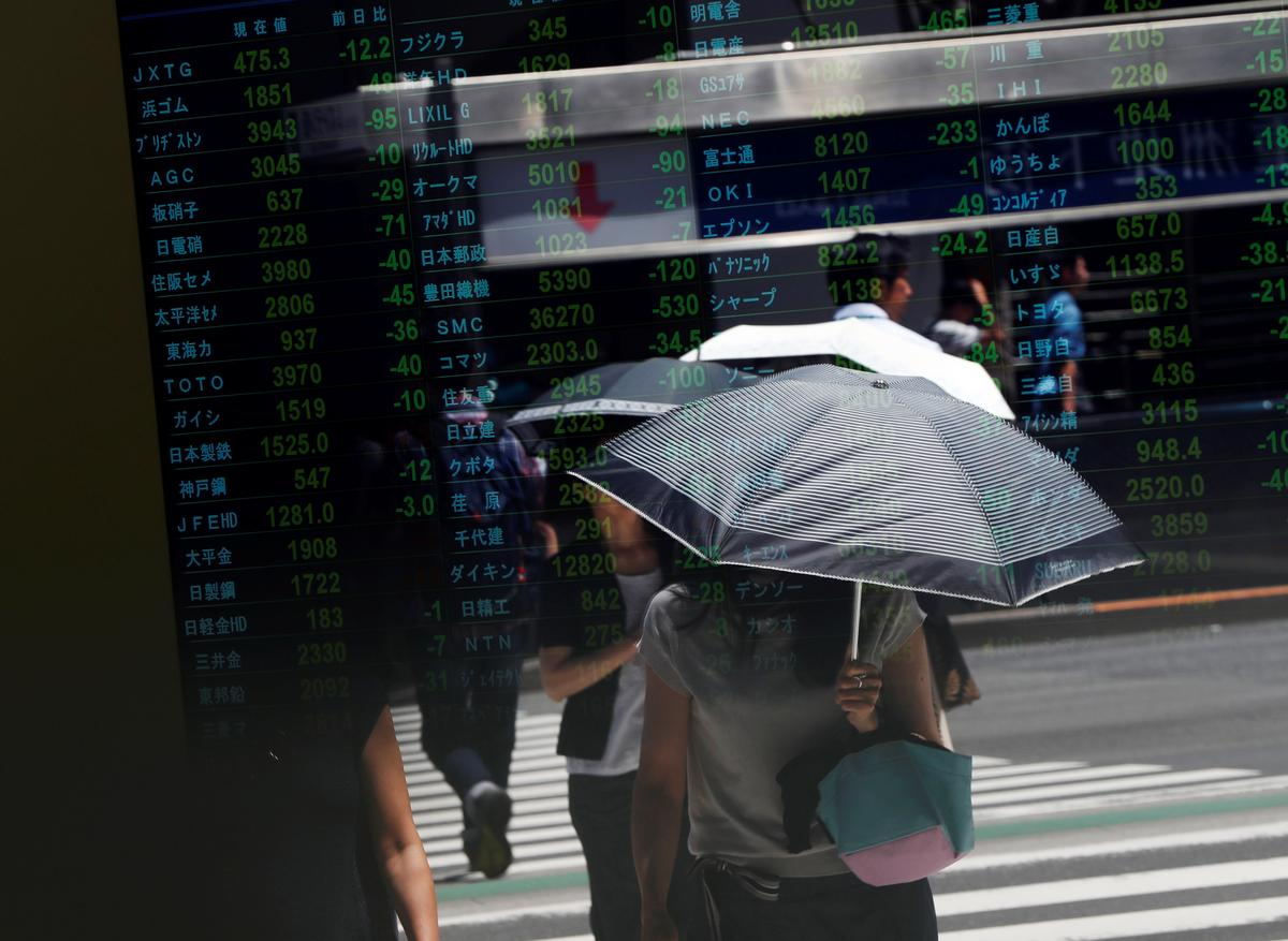 Asian shares edge lower, Japan hurt by Sino-U.S. tensions