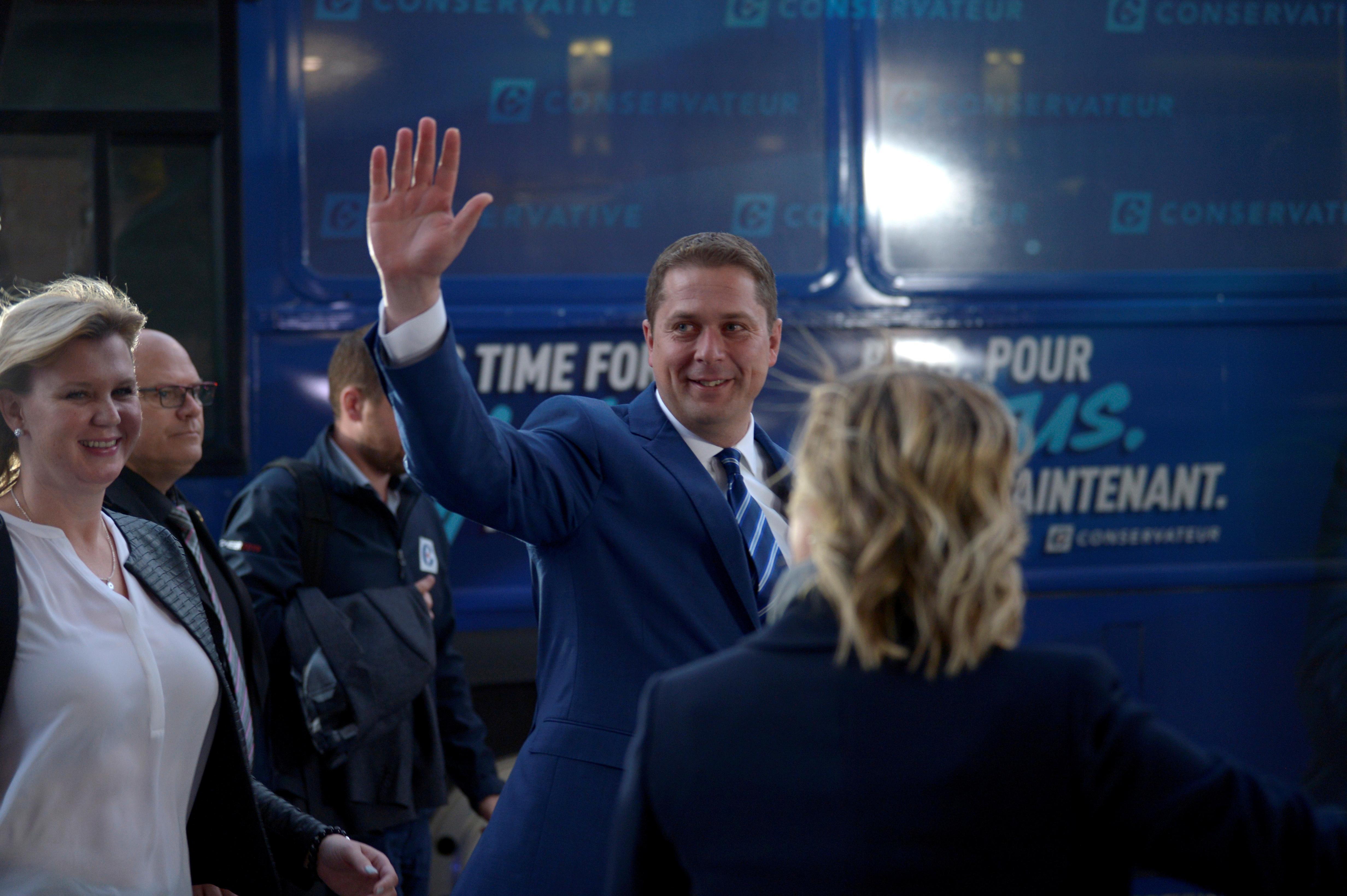 Canada Conservative leader forced on defensive over dual...