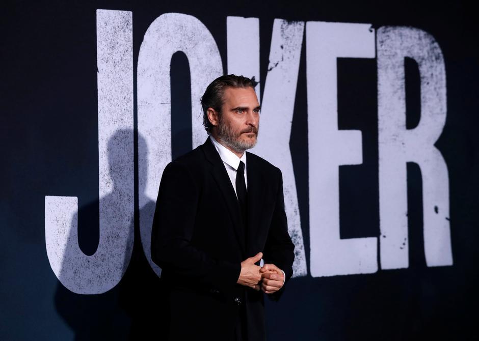 "Hasil gambar untuk Joaquin Phoenix attends the premiere for the film ""Joker"" in Los Angeles, California, U.S., September 28, 2019. REUTERS/Mario Anzuoni - RC1882E04CF0"
