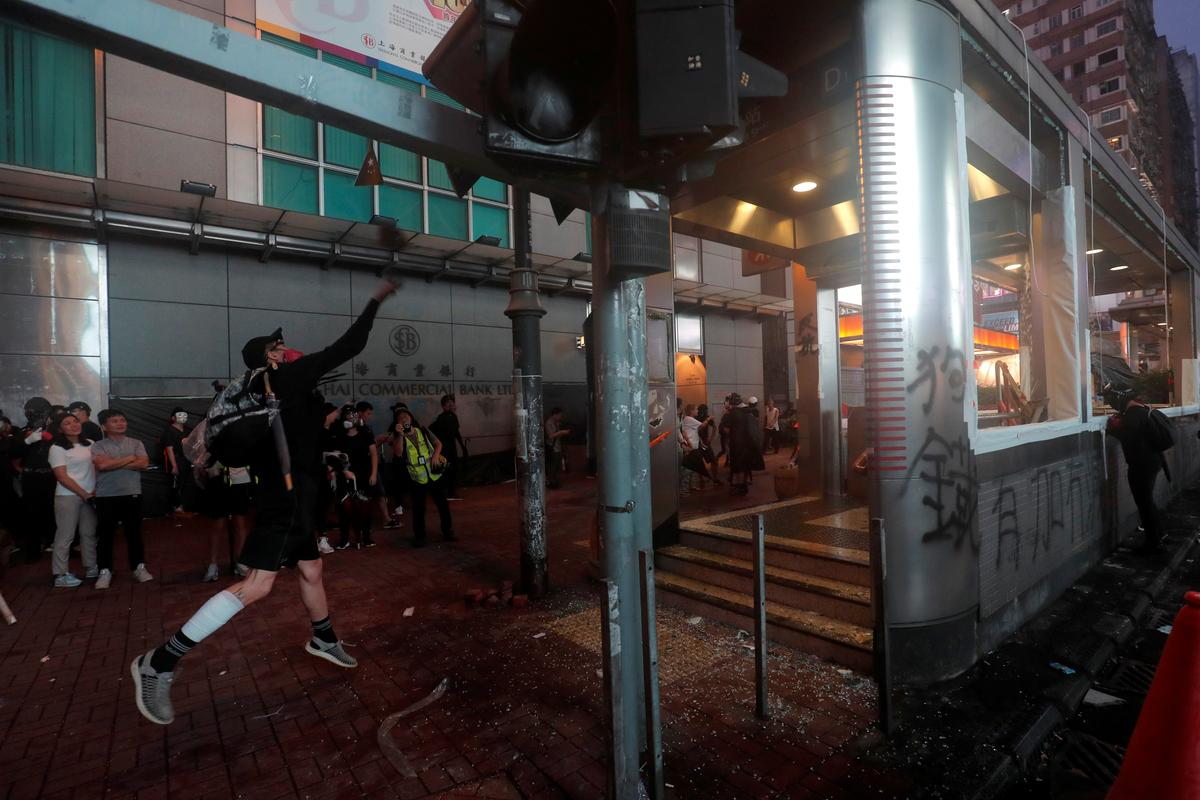 Hong Kong metro partially reopens, city struggles after violent weekend