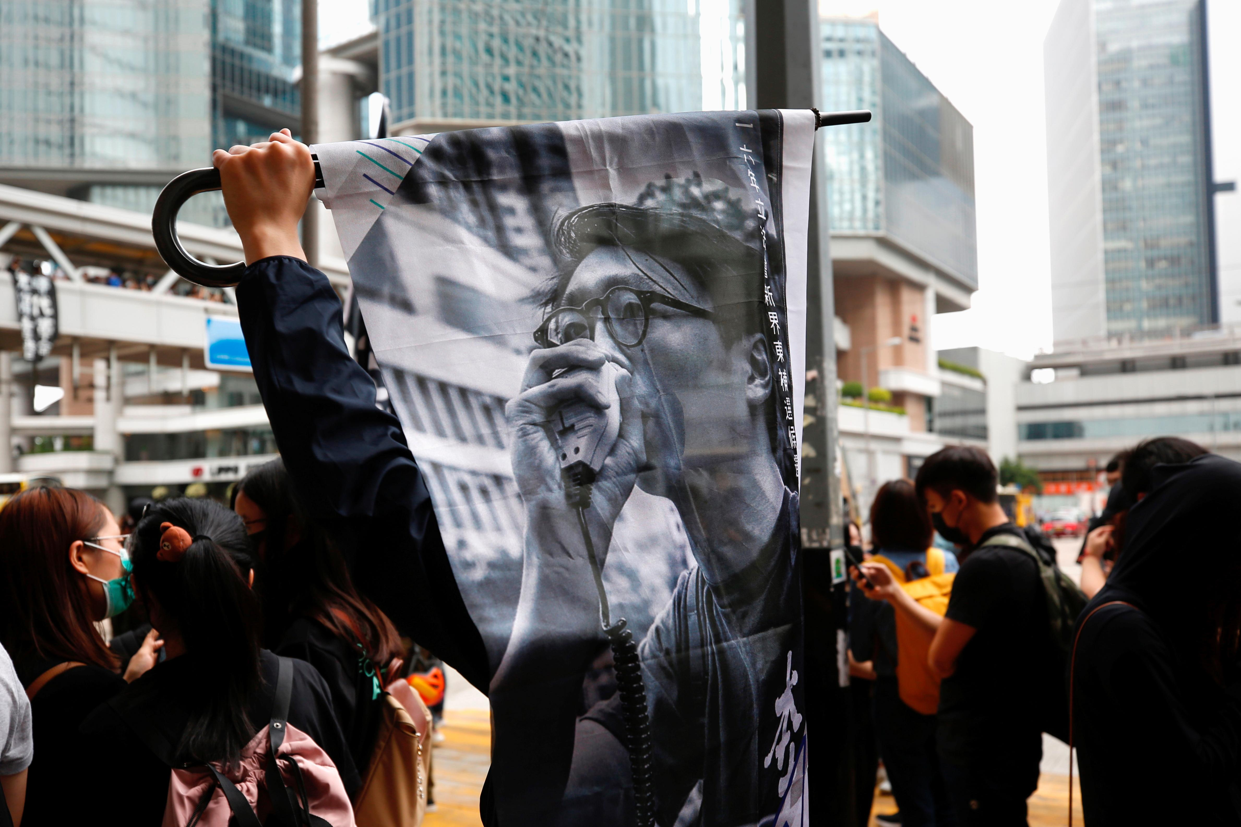 """UPDATE 2-Hundreds of black-clad activists chant """"Liberate Hong Kong"""" outside High Court"""