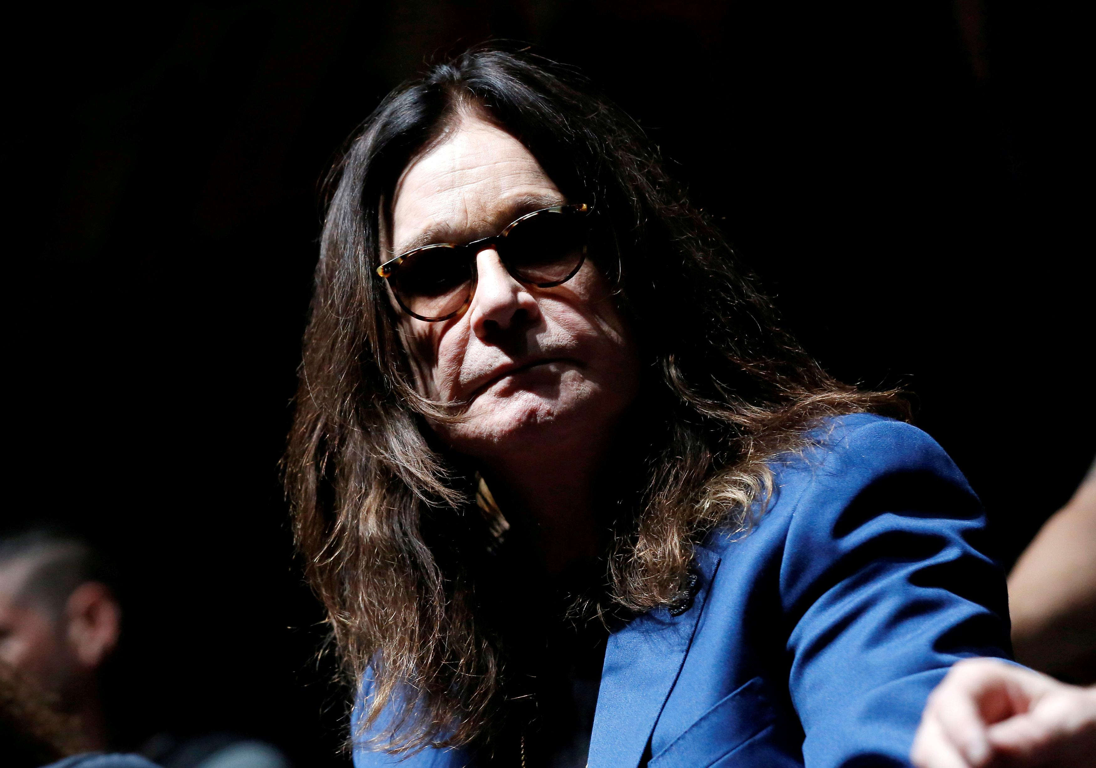 Ozzy Osbourne says he's recovering,'not dying,' but again postpones...