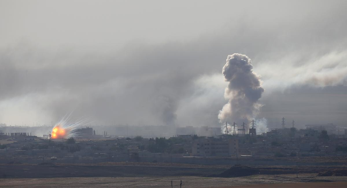 Turkish forces intensify bombardment around Syrian town
