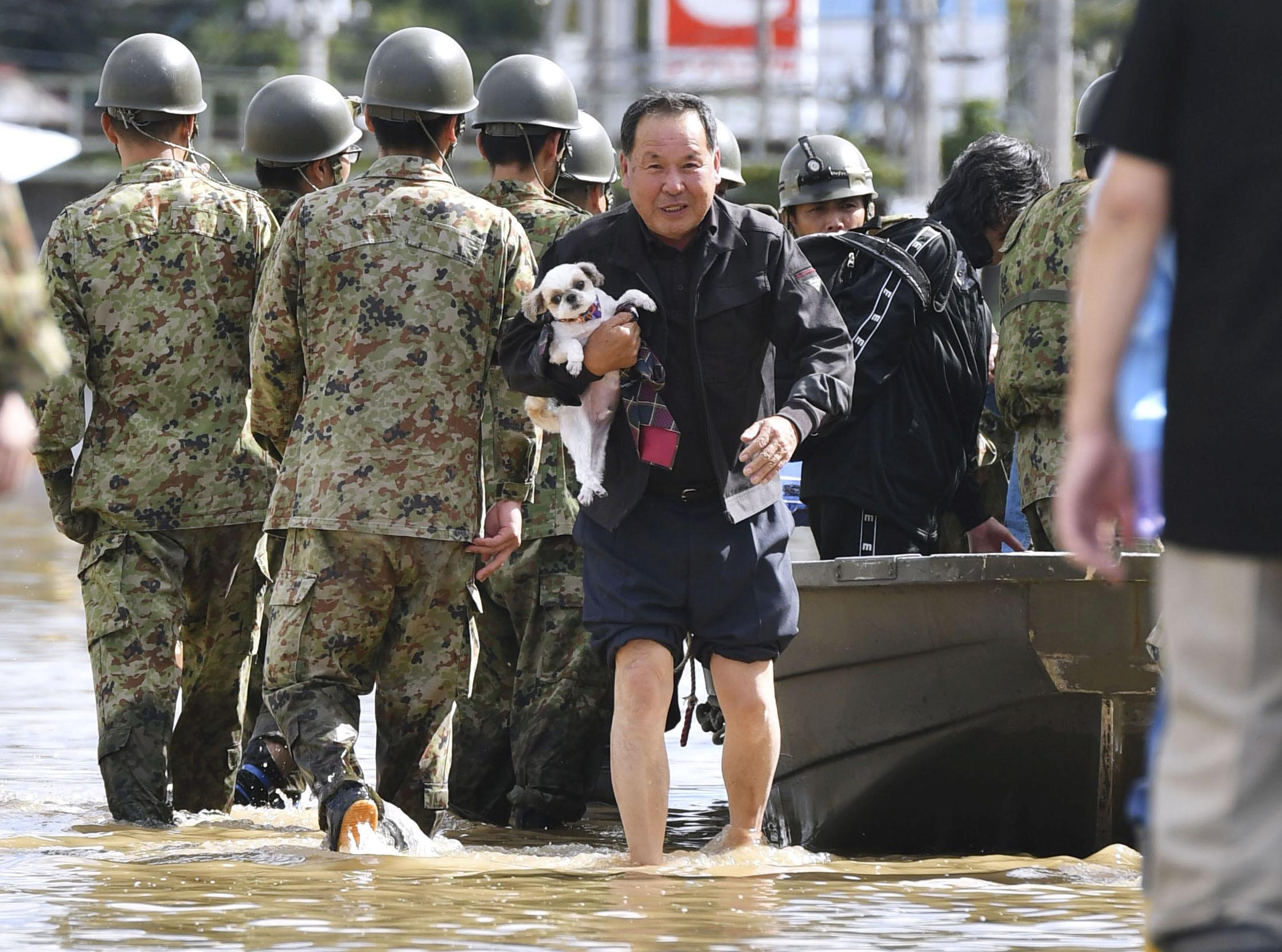Japan sends in troops after deadly typhoon floods towns