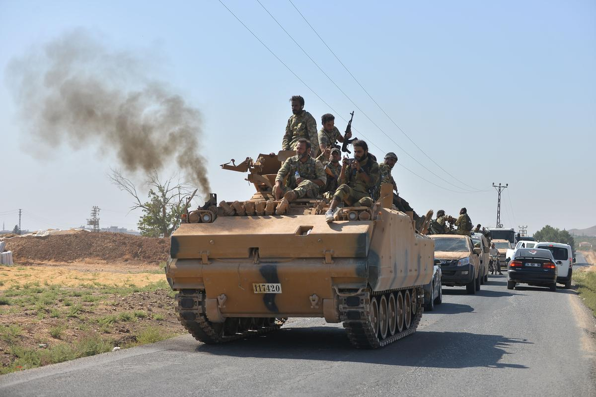 Syrian army begins to move troops to 'confront' Turkey in northern...