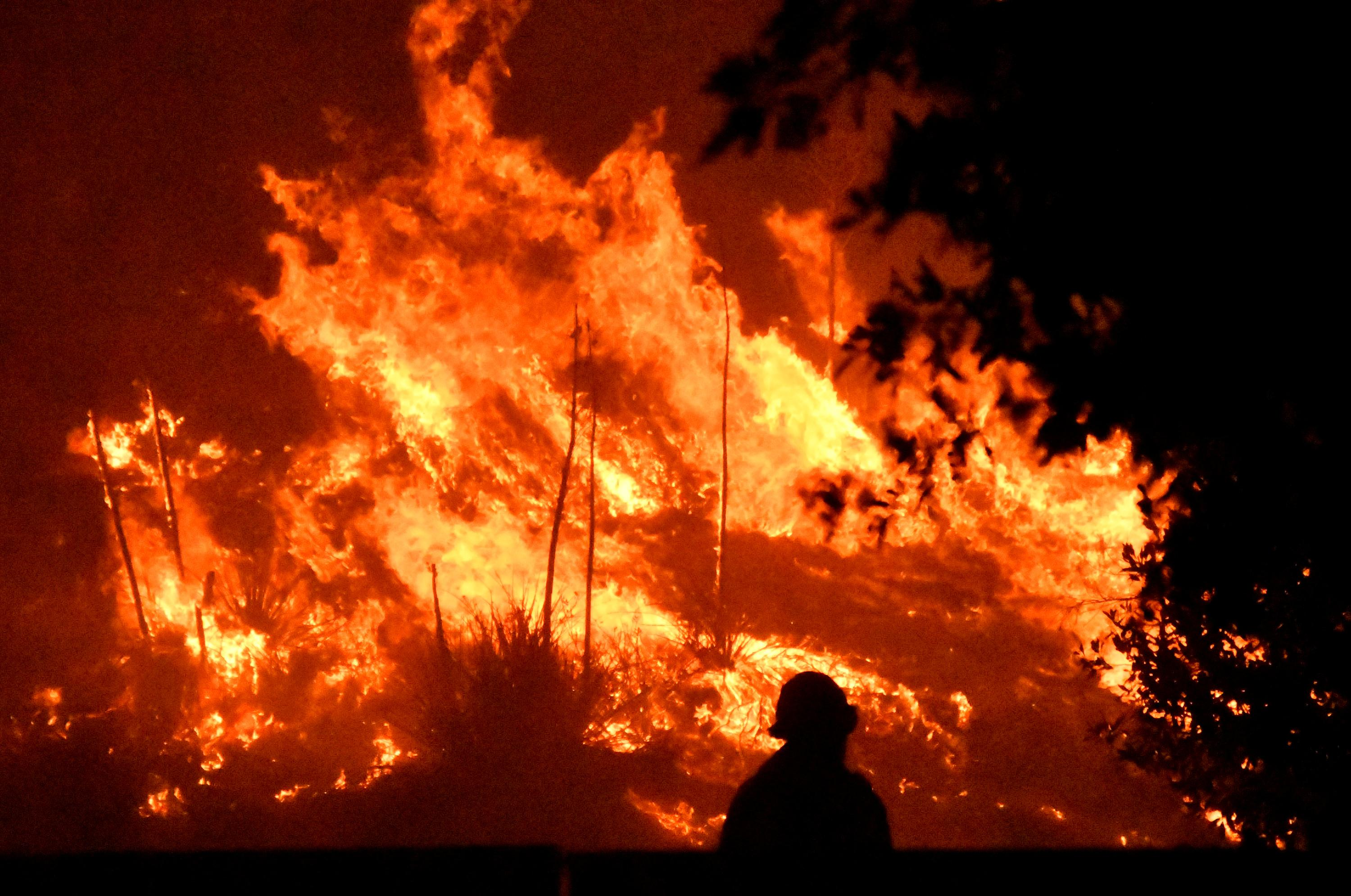Deadly Los Angeles wildfire burns with subdued fury after change in...