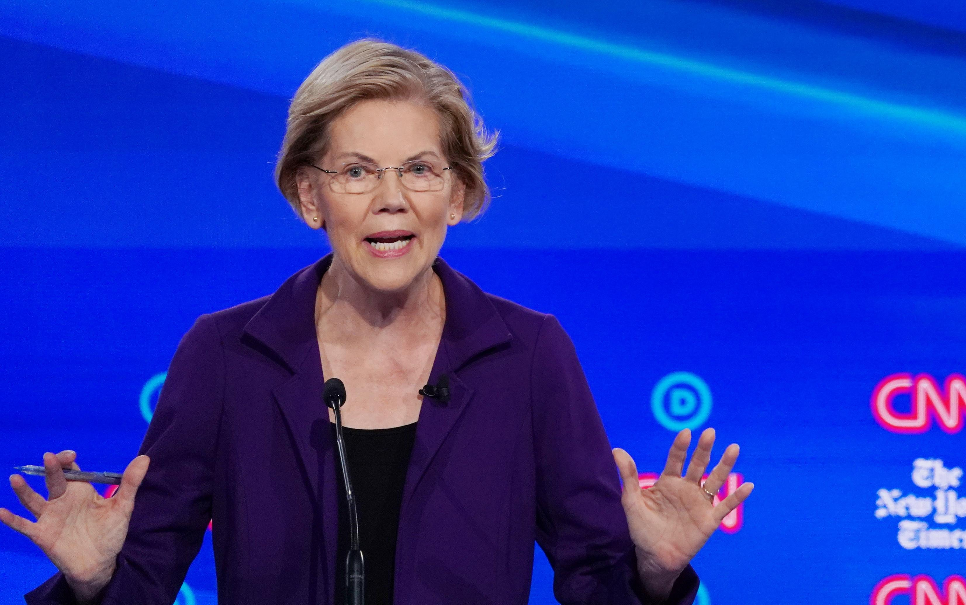 Warren comes under attack on healthcare, taxes at U.S. Democratic...