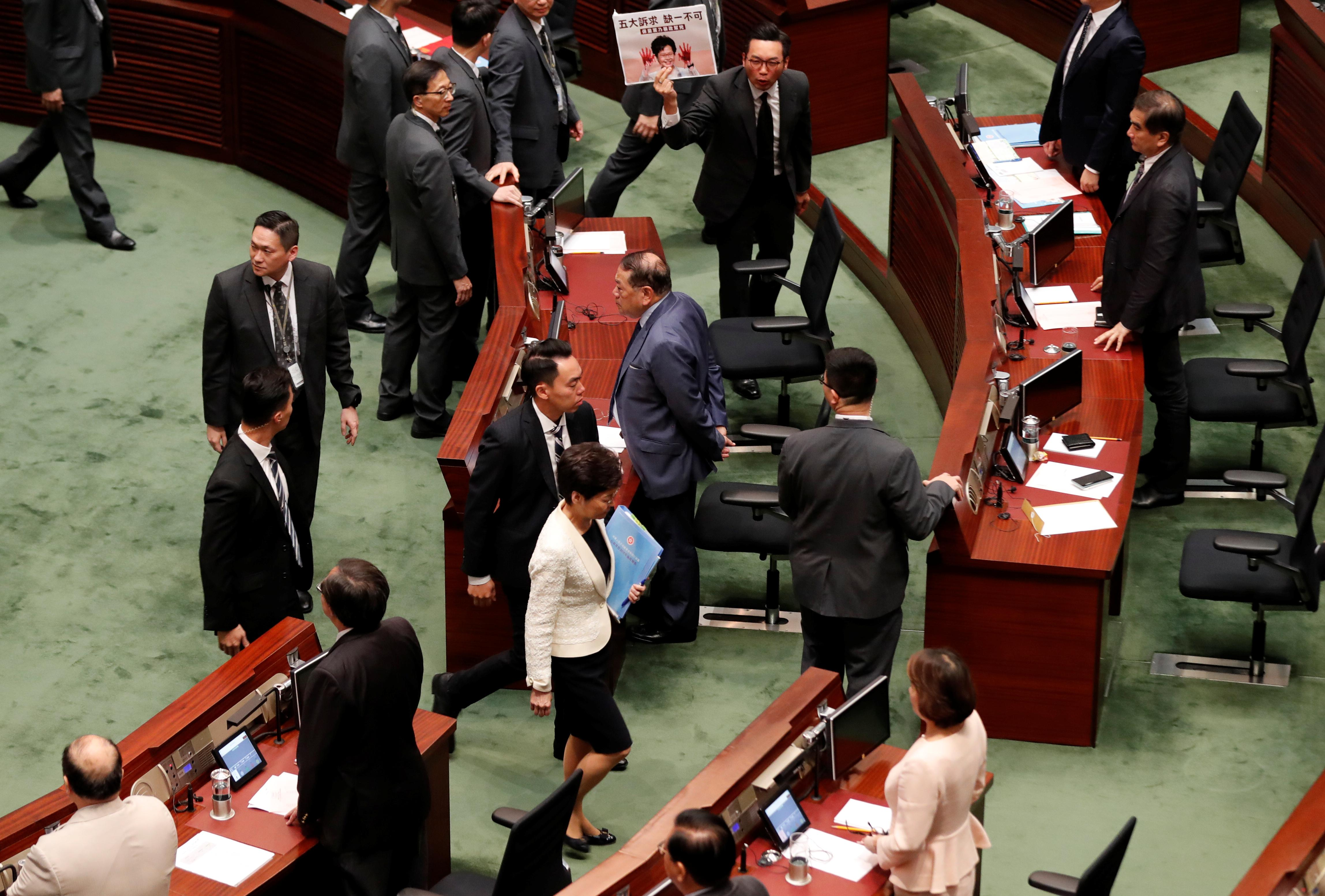 Hong Kong assembly in chaos; attack on democracy leader a 'chilling...