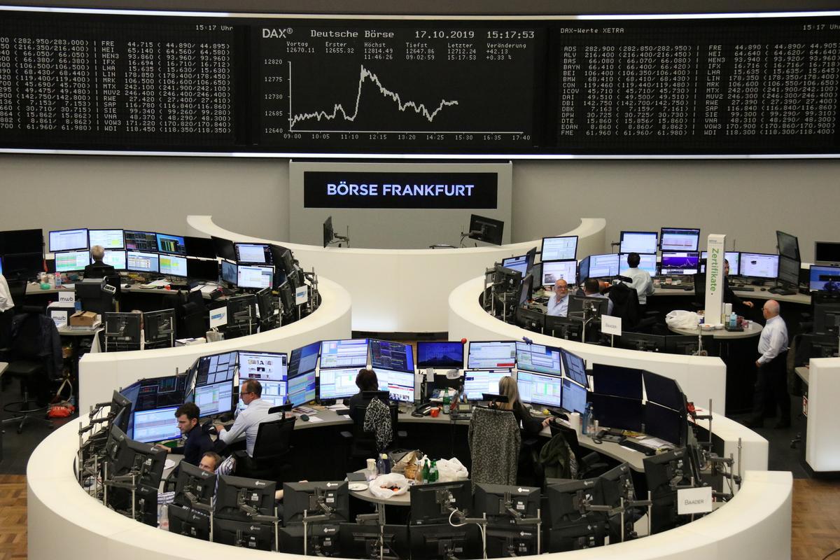 String of weak earnings leave European stocks barely up on the week
