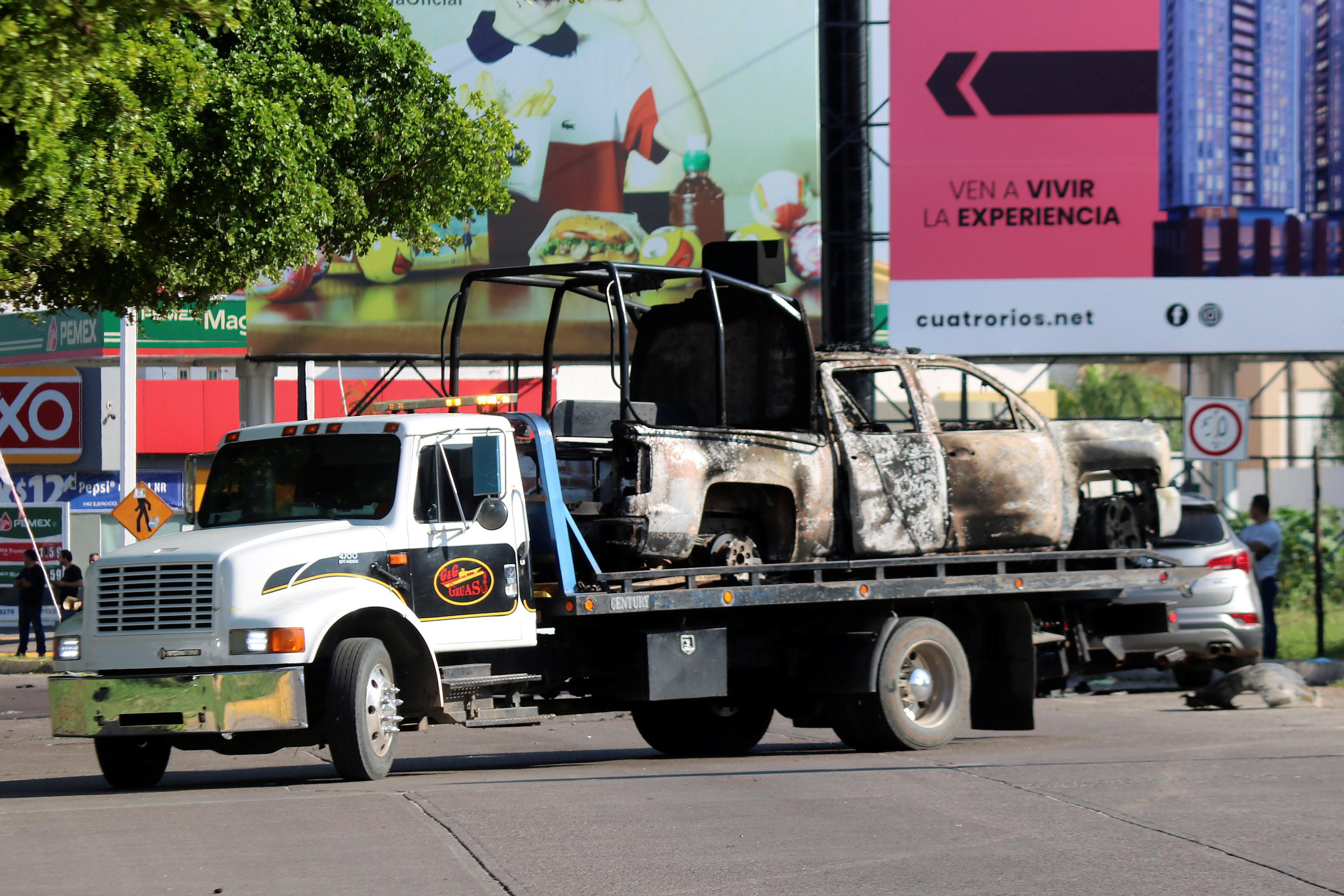 Shocked by cartel firefight, Mexico's Culiacan seeks return to...