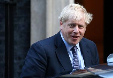Britain's Prime Minister Boris Johnson leaves Downing Street to head for...