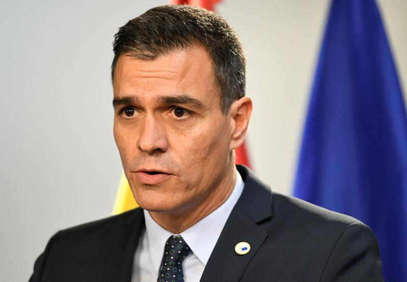 Spanish PM tells Catalan leader to denounce violence