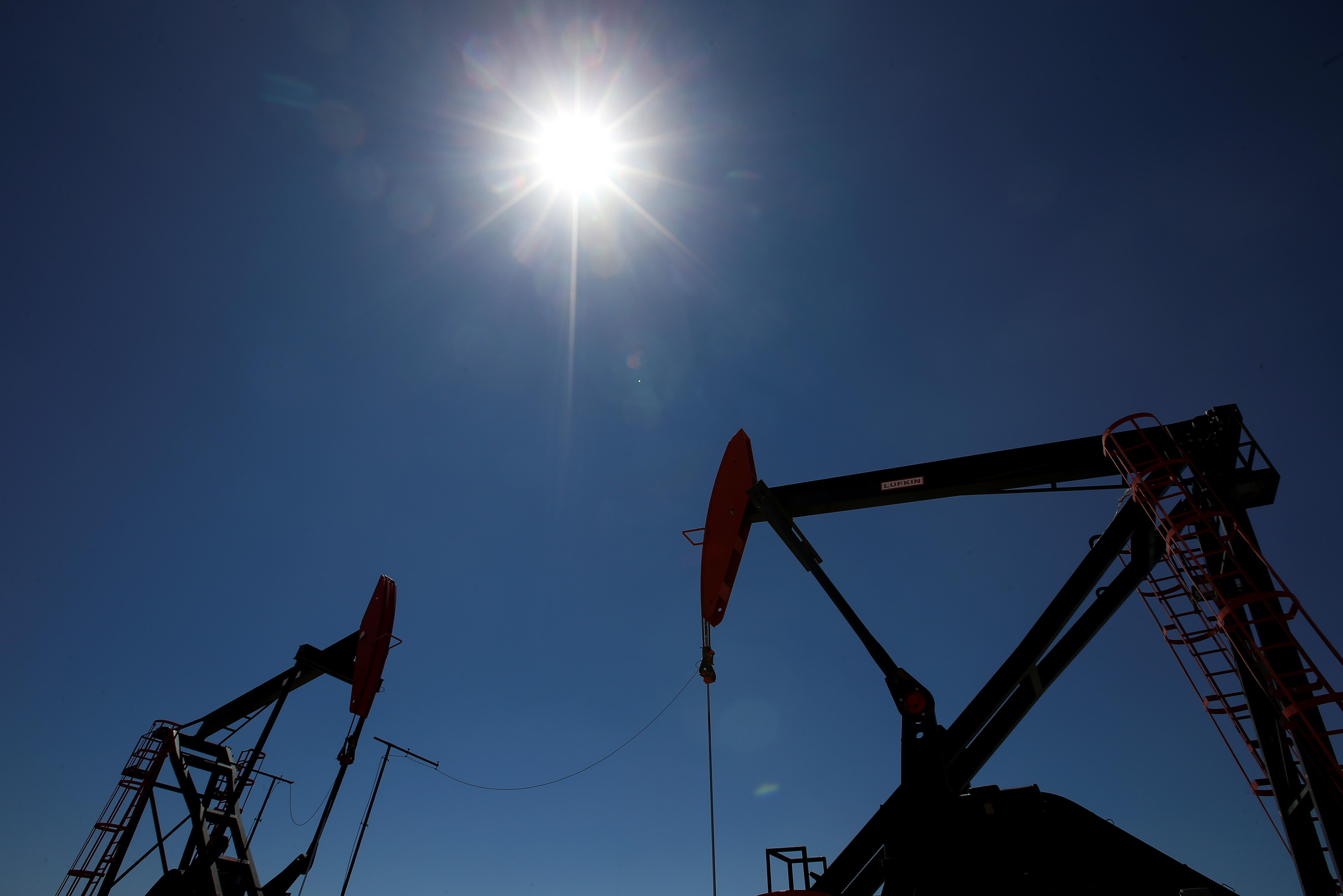Oil prices dragged lower by sluggish demand, supply outlooks