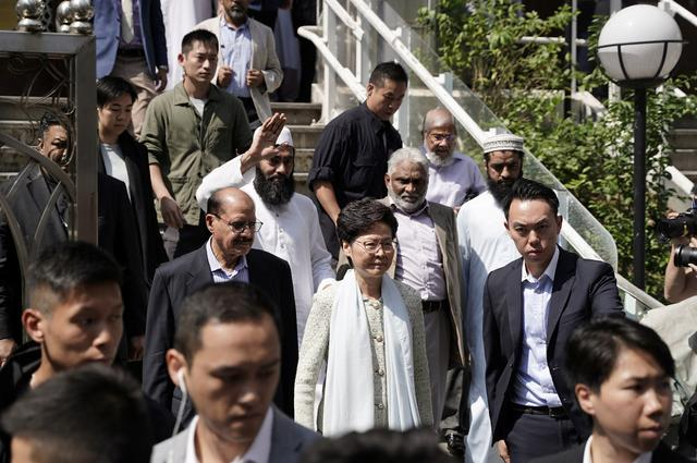 Hong Kong's Chief Executive Carrie Lam (C) exits the Kowloon Mosque, or Kowloon Masjid and Islamic Centre, in Tsim Sha Tsui district in Hong Kong, China October 21, 2019. REUTERS/Stringer