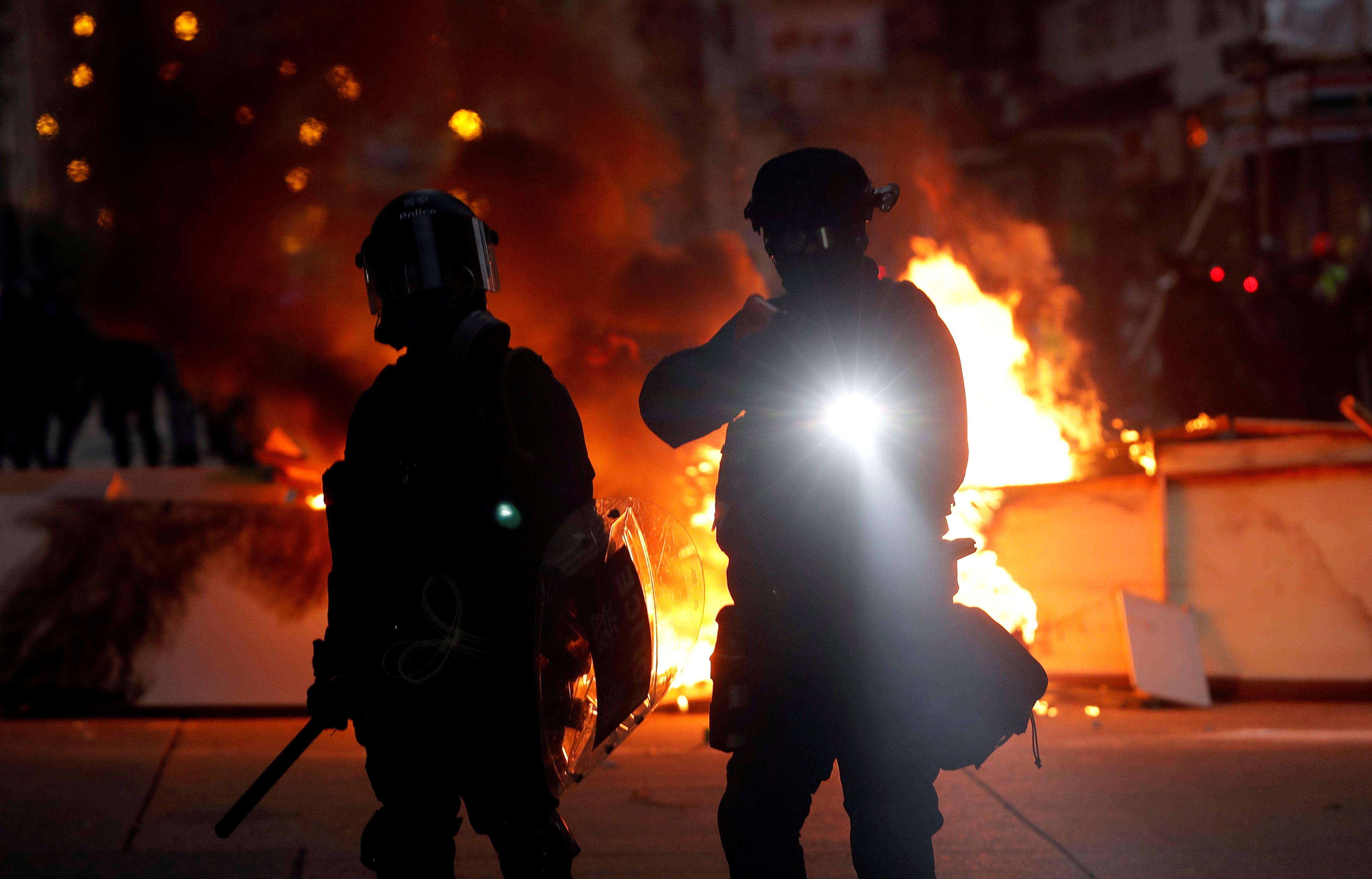 Hong Kong riot police teargas, chase protesters, residents jeer...