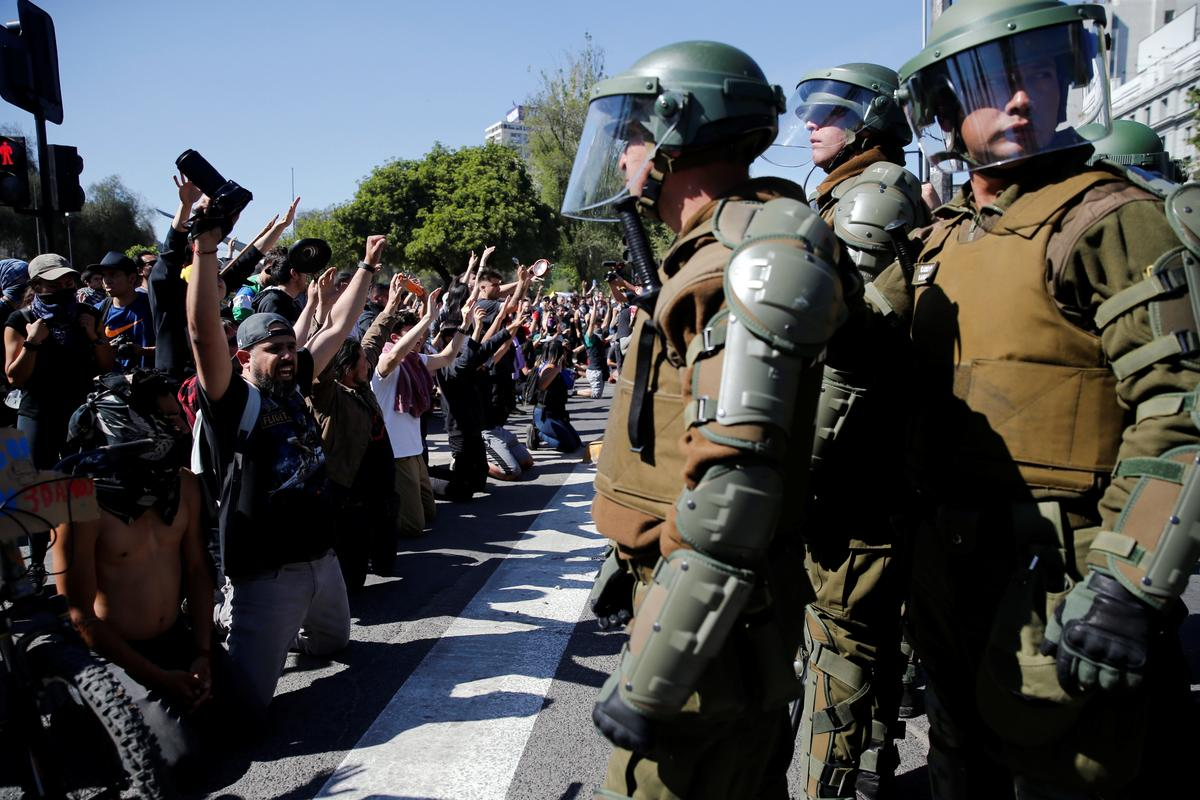 After Chile riots, thousands rally to protest at Pinera government