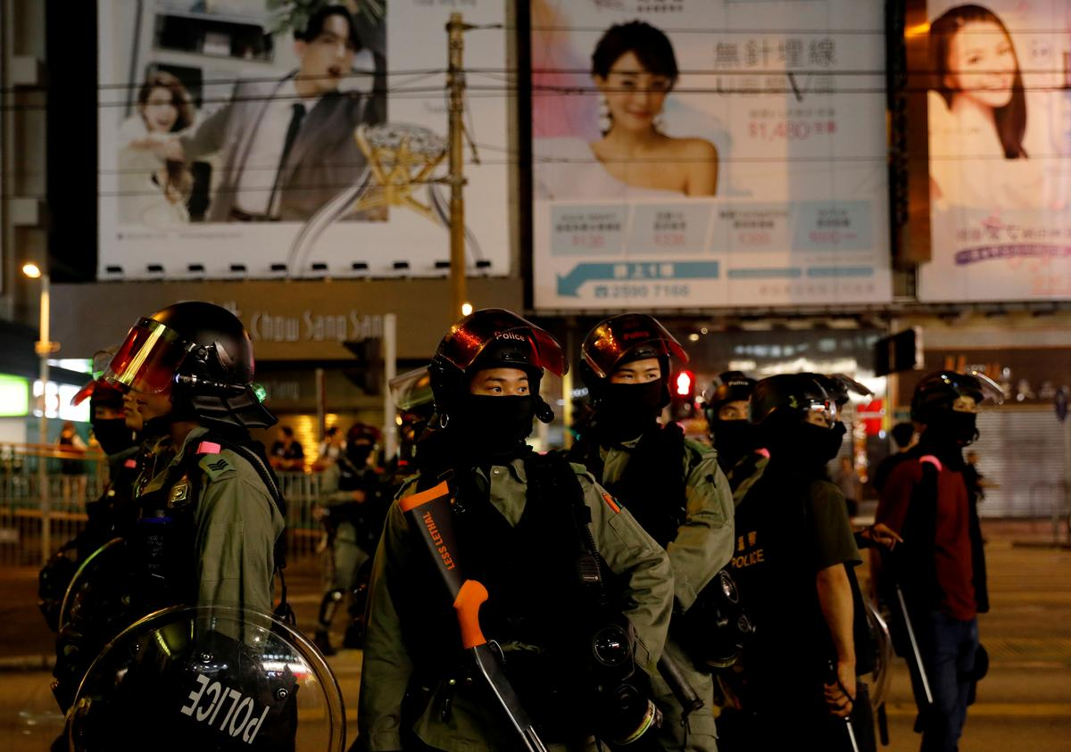 Hong Kong government pledges more aid to battered city, no end in sight to unrest