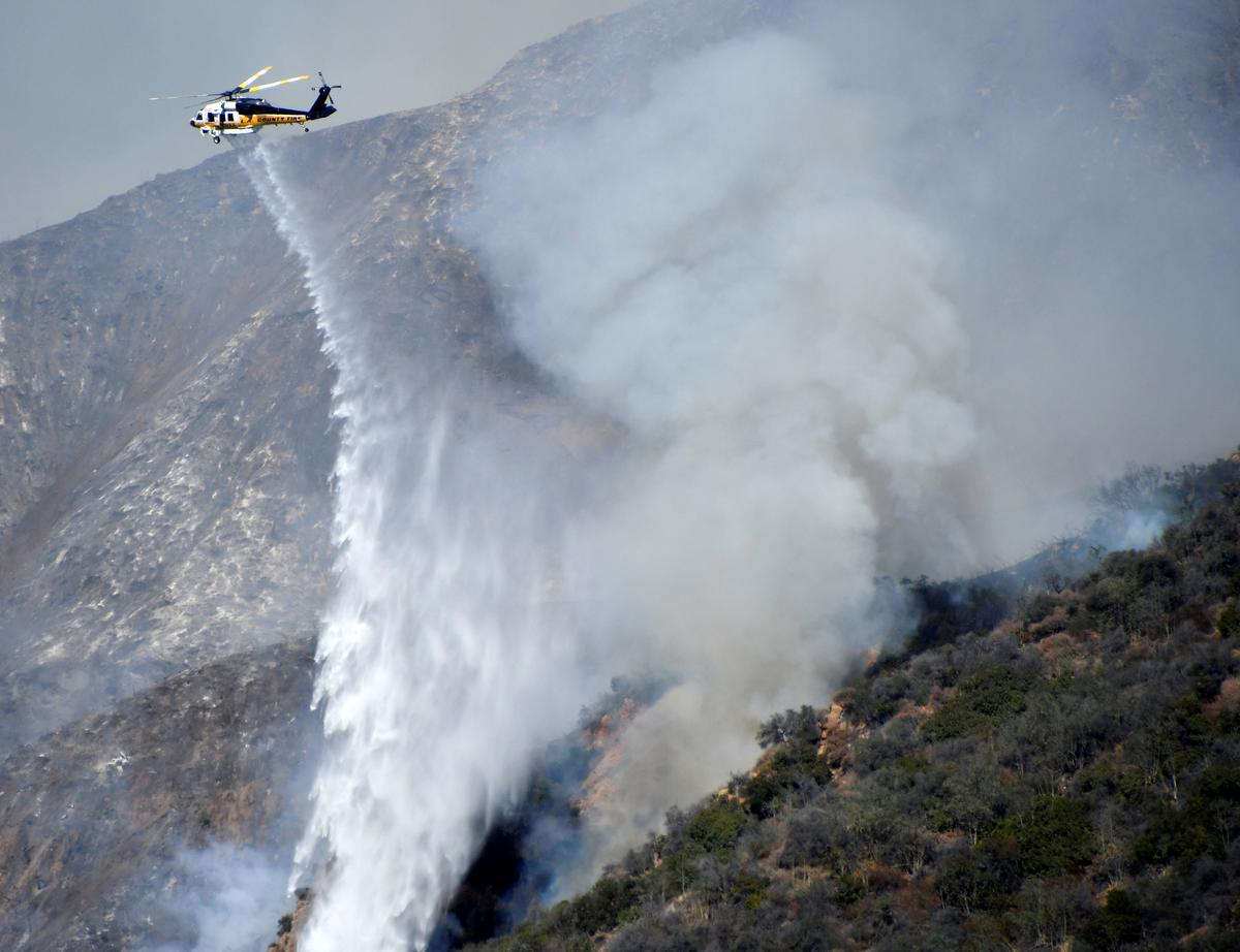 Wildfire threatens homes, prompts evacuations in California