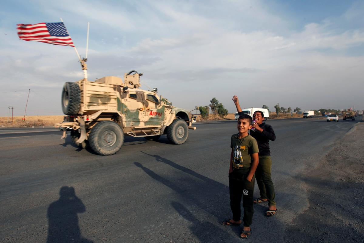 U.S. forces withdrawing from Syria into Iraq have no approval to stay: Iraqi military