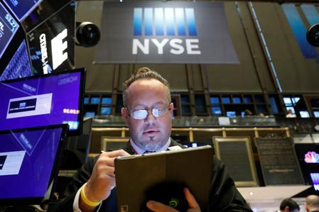 S&P 500, Dow gain on upbeat earnings reports; Facebook pressures Nasdaq