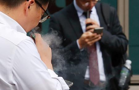 "UPDATE 2-S.Korea warns of ""serious risk"" from vaping, considers sales ban"