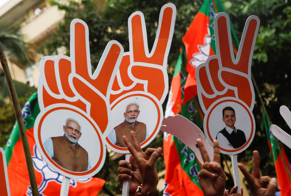 India's ruling BJP wins in big western state, scouts for ally in other