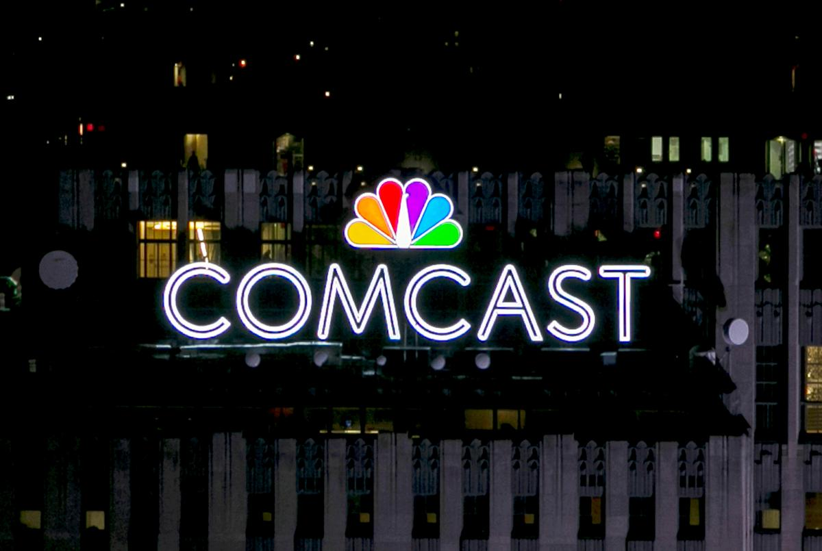 Comcast tops profit forecast as it gains high-speed internet customers