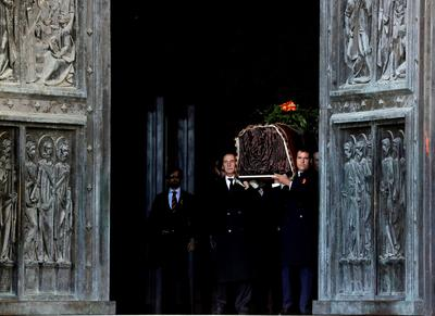 Confronting its troubled past, Spain exhumes late dictator Franco